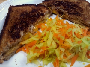 cooked kohlrabi and carrots with grilled cheese sandwich